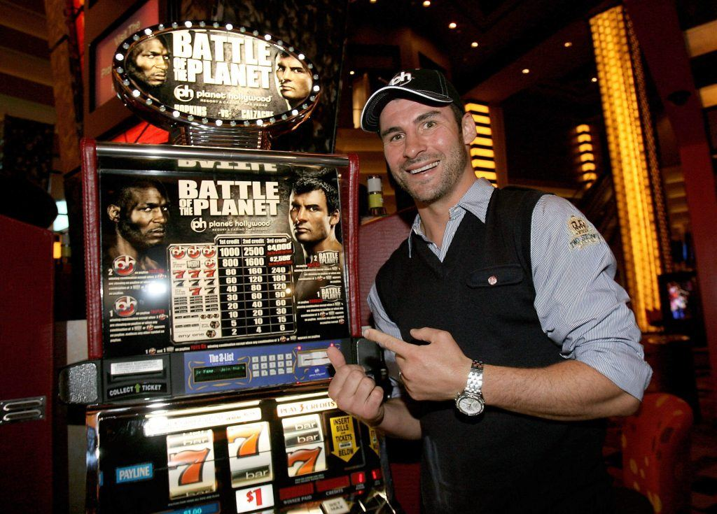 Joe Calzaghe in front of a slot machine
