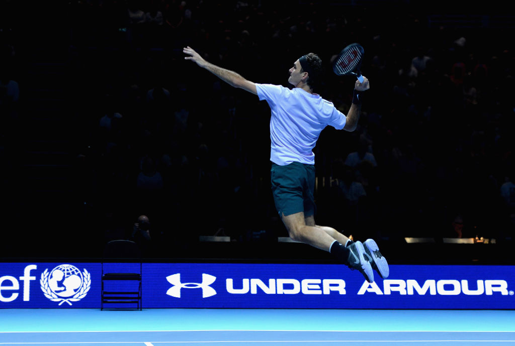 Roger Federer jumping and making a nice shot